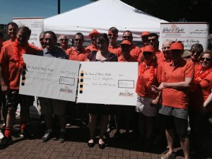 What's Right team giving cheques to good causes.