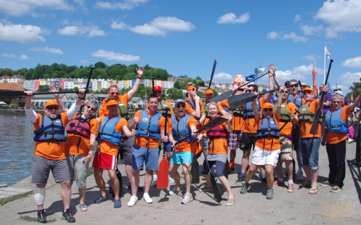 The team on the slipway getting ready to get into their dragon boat. I'm the one in red shorts.